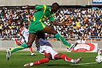A Yanga player jumps over his Simba opponent on his way to the goal. Simba played the Yanga Bomba football team in Dar Es Salaam, Tanzania on Sunday, October 26, 2008. Yanga won the match 1-0.