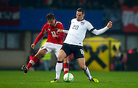 VIENNA, Austria - November 19, 2013: Geoff Cameron and Austria's Martin Harnik during a 0-1 loss to host Austria during the international friendly match between Austria and the USA at Ernst-Happel-Stadium.