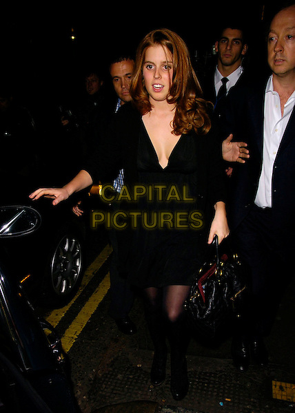 HRH PRINCESS BEATRICE OF YORK.The Tatler's Little Black Book launch party, 24 nightclub, 24 Kingsley St., London, UK..November 9th, 2006.Ref: CAN.full length black dress plunging neckline cleavage bag purse.www.capitalpictures.com.sales@capitalpictures.com.©Can Nguyen/Capital Pictures