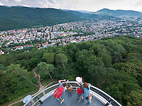 Germany, DEU, Baden-Wurttemberg, Freiburg im Breisgau, 2010Jul30: A family has climbed up the Schlossbergturm (castle hill tower) on the Freiburg Schlossberg (castle hill), and looks east toward the Schwarzwald (Black Forest).
