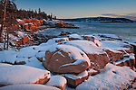 A winter sunrise on the rocky coast near Otter Cliffs, Acadia National Park, ME, USA
