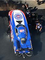 Jun 17, 2016; Bristol, TN, USA; Crew members with NHRA funny car driver Robert Hight during qualifying for the Thunder Valley Nationals at Bristol Dragway. Mandatory Credit: Mark J. Rebilas-USA TODAY Sports