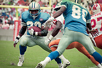Barry Sanders carries the ball, Detroit Lions at Tampa Bay Buccaneers NFL football game won by Tampa Bay 24-14 at Tampa Stadium, in Tampa , Florida on Sunday October 2, 1994 . (Photo by Brian Cleary/bcpix.com)