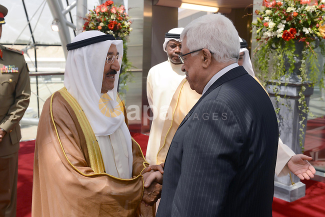 Palestinian President Mahmoud Abbas, Right, shakes hands with Emir of Kuwait Sheikh Sabah al-Ahmad al-Sabah upon his arrival to Kuwait, on April 15, 2013. Abbas will inaugurate the Palestinian embassy in Kuwait since 22 years after it was shut down. Photo by Thaer Ganaim