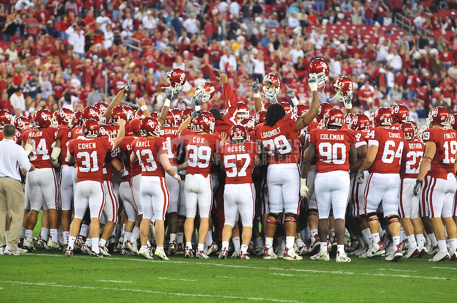 Jan 2, 2008; Glendale, AZ, USA; Oklahoma Sooners players huddle together prior to the game against the West Virginia Mountaineers during the Fiesta Bowl at University of Phoenix Stadium. Mandatory Credit: Mark J. Rebilas-US PRESSWIRE
