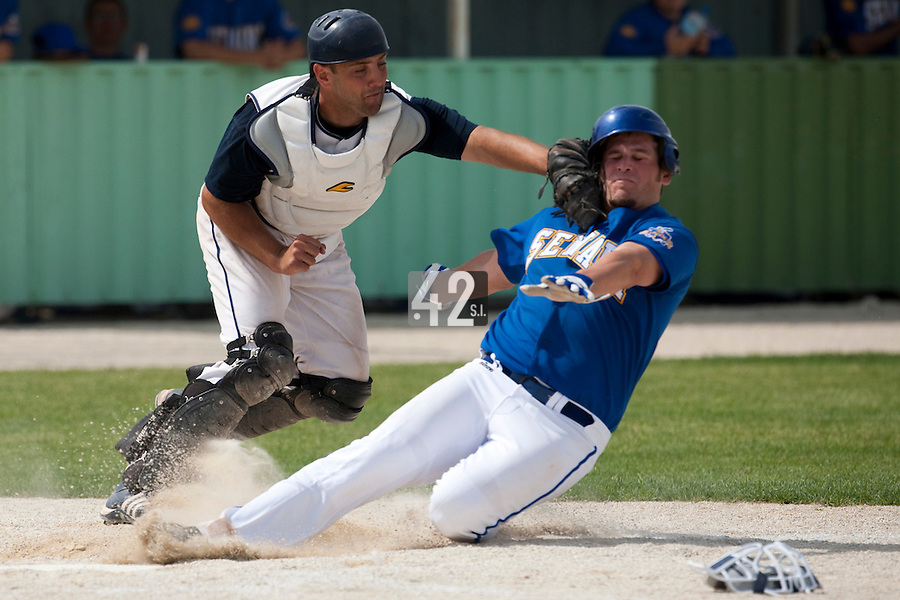 22 May 2009: Jean-Michel Mayeur of Montpellier tags out Rhett Teller of Senart during the 2009 Challenge de France, a tournament with the best French baseball teams - all eight elite league clubs - to determine a spot in the European Cup next year, at Montpellier, France. Senart wins 7-1 over Montpellier.