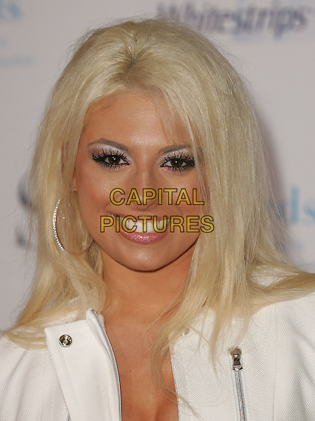 TAWNY.The 1st Annual Crest White Strips Style Awards held at The Beverly Hills Hotel in Beverly Hills, California .June 16,2004.headshot, portrait, hoop earrings, clumpy mascara, eye make-up, glitter.www.capitalpictures.com.sales@capitalpictures.com.©Capital Pictures