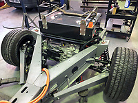 BNPS.co.uk (01202 558833)<br /> Pic: Castleman/BNPS<br /> <br /> The Tesla batteries after fitting to the stripped back chassis.