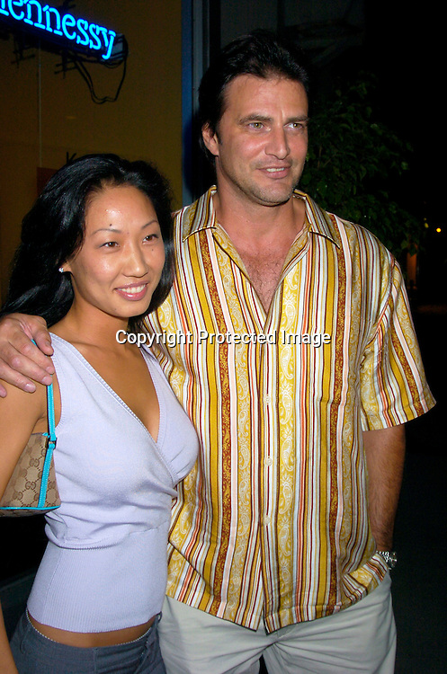 John Enos and girlfriend Jennie Lee..at the opening of new bar  17 on July 14, 2004 in New York City. John Enos is one of the owners. Lizzie Grubman was ..being filmed for a realty show on MTV...Photo by Robin Platzer, Twin Images..