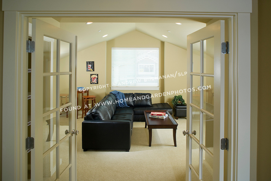 A builder spec home in the Pacific Northwest suburbs of Seattle offers this great bonus room over the garage that's perfect for a family room, game room, media room, or even a guest bedroom suite with the adjacent bathroom.