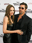 "HOLLYWOOD, CA. - August 10: Angelina Jolie and Brad Pitt arrive at the Los Angeles premiere of ""Inglorious Basterds"" at the Grauman's Chinese Theatre on August 10, 2009 in Hollywood, California."