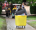New student Kendall Bell from Chicago pushes a cart to his residence hall on the campus of Harris-Stowe State University in St. Louis during freshman move-in day on Wednesday August 15, 2018. He plans on trying out for both the basketball and track teams as he pursues a liberal arts degree.    Photo by Tim Vizer