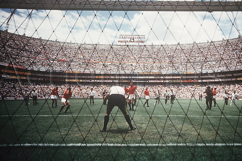 1970 World Cup Finals, Mexic. Picture shows a backdrop of the  Aztek stadium in Mexiko-designed to hold up to 108.500 fans. The stadium was expanded to manage the 197o world cup finals and final game for the 1970's tournament.