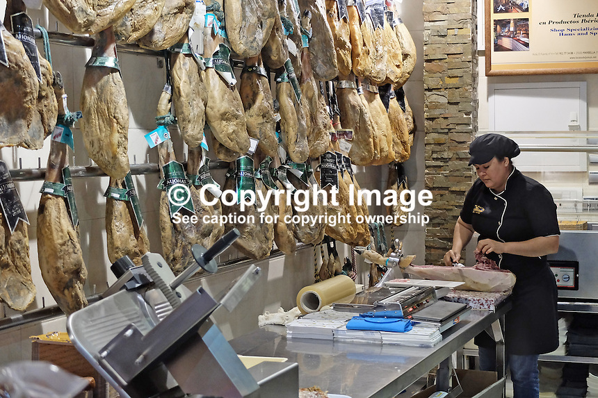 Iberian air-dried ham is a big favourite with Spaniards to such an extent that some shops sell little else. It is best eaten freshly cut and wafer-thin. It is produced from black Iberian pigs. This particular store is in Marbella, Malaga Province, Spain, 201503130532<br /> <br /> Copyright Image from Victor Patterson, 54 Dorchester Park, Belfast, UK, BT9 6RJ<br /> <br /> t: +44 28 9066 1296<br /> m: +44 7802 353836<br /> vm +44 20 8816 7153<br /> <br /> e1: victorpatterson@me.com<br /> e2: victorpatterson@gmail.com<br /> <br /> www.victorpatterson.com<br /> <br /> IMPORTANT: Please see my Terms and Conditions of Use at www.victorpatterson.com