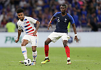 Lyon, France - Saturday June 09, 2018: Weston McKennie, Paul Pogba during an international friendly match between the men's national teams of the United States (USA) and France (FRA) at Groupama Stadium.