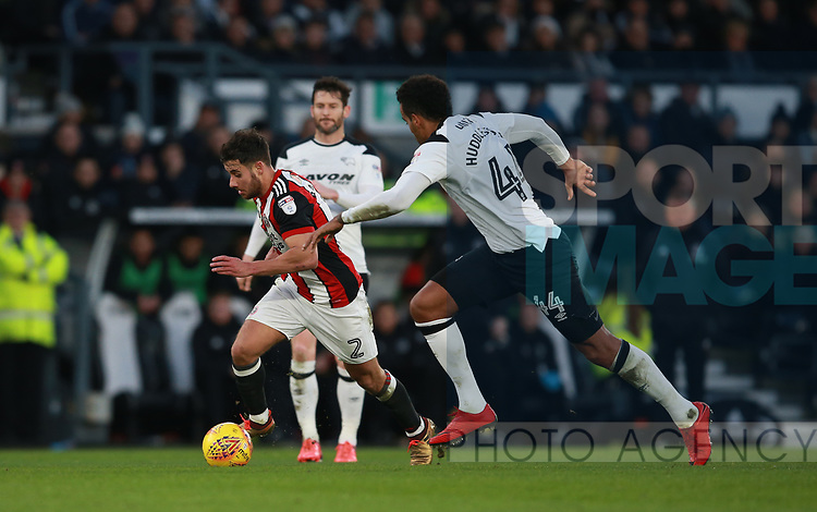 George Baldock of Sheffield Utd tackled by Tom Huddlestone of Derby County during the Championship match at the Pride Park Stadium, Derby. Picture date 1st January 2018. Picture credit should read: Simon Bellis/Sportimage