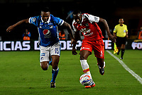 BOGOTA - COLOMBIA - 22 – 01 - 2018: Sebastian Ayala (Izq.) jugador de Millonarios disputa el balón con Juan David Valencia (Der.) jugador de Independiente Santa Fe, durante partido entre Millonarios y el Independiente Santa Fe, por el Torneo Fox Sports 2018, jugado en el estadio Nemesio Camacho El Campin de la ciudad de Bogota. / Sebastian Ayala (L) player of Millonarios vies for the ball with Juan David Valencia (R) player of Independiente Santa Fe, during a match between Millonarios and Independiente Santa Fe, for the Fox Sports Tournament 2018, played at the Nemesio Camacho El Campin stadium in the city of Bogota.Photo: VizzorImage / Luis Ramirez / Staff.