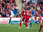 Aberdeen v St Johnstone...31.08.13      SPFL<br /> Chris Millar clears from Josh Magennis<br /> Picture by Graeme Hart.<br /> Copyright Perthshire Picture Agency<br /> Tel: 01738 623350  Mobile: 07990 594431