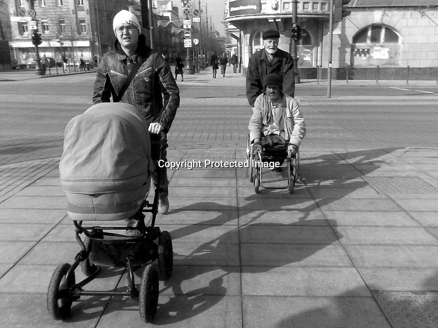 Lithuania, Vilnius. Men working