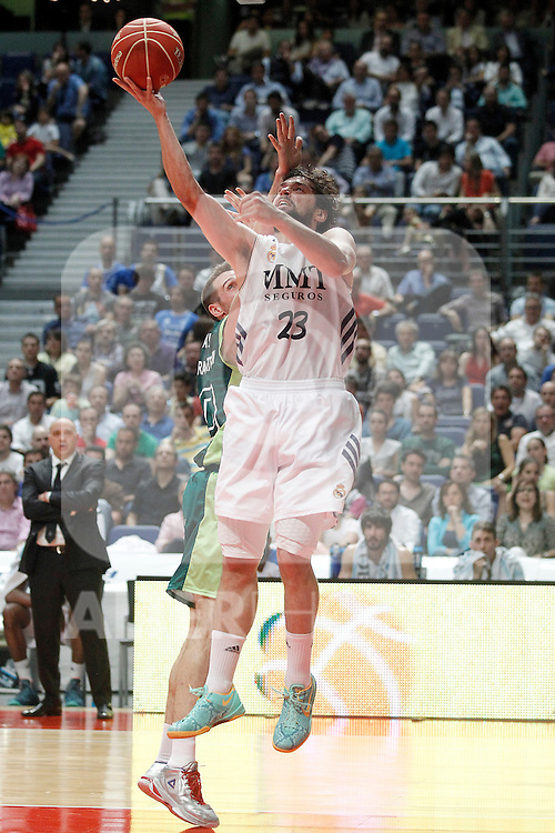 Real Madrid's Sergio Llull (r) and Unicaja's Txemi Urtasun during Liga Endesa ACB Semifinal match.June 6,2014. (ALTERPHOTOS/Acero)