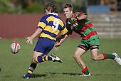 K. Hancy gets a kick away as S Kennedy applies pressure. Counties Manukau Premier Club Rugby, Waiuku vs Patumahoe played at Rugby Park, Waiuku on the 8th of April 2006. Waiuku won 18 - 15