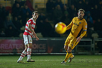 John Marquis of Doncaster Rovers sees his shot saved alongside Darren Jones of Newport County during the Sky Bet League 2 match between Newport County and Doncaster Rovers at Rodney Parade, Newport, Wales on 10 February 2017. Photo by Mark  Hawkins / PRiME Media Images.