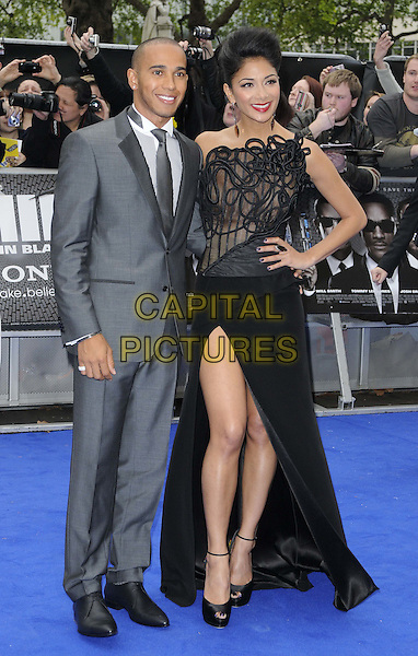 Lewis Hamilton & Nicole Scherzinger.The 'Men in Black 3' UK film premiere, Odeon Leicester Square cinema, Leicester Square, London, England..May 16th, 2012.MIB3 III full length grey gray suit black dress lace one shoulder hand on hip slit split couple.CAP/CAN.©Can Nguyen/Capital Pictures.
