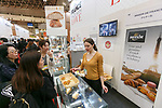 An exhibitor shows her products at the France booth during the 42nd International Food and Beverage Exhibition (FOODEX JAPAN 2017) in Makuhari Messe International Convention Complex on March 8, 2017, Chiba, Japan. About 3,282 companies from 77 nations are participating in the Asia's largest food and beverage trade show. This year organizers expect 77,000 visitors for the four-day event, which runs until March 10. (Photo by Rodrigo Reyes Marin/AFLO)