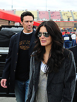 Feb 22, 2009; Fontana, CA, USA; Television/movie actress Angie Harmon and former football player Jason Sehorn tour the garage prior to the Auto Club 500 at Auto Club Speedway. Mandatory Credit: Mark J. Rebilas-
