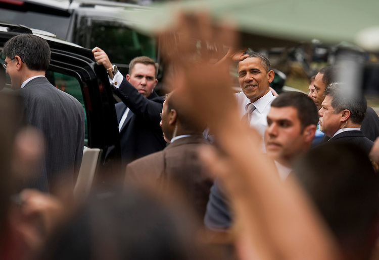 UNITED STATES - AUGUST 03:  President Barack Obama waves to a crowd gathered outside of Good Stuff Eatery on Pennsylvania Avenue, SE, after lunch with members of his staff who were key negotiators in the debt ceiling talks.  Jacob Lew, director of the Office of Management and Budget (OMB) appears at far left.  (Photo By Tom Williams/Roll Call)