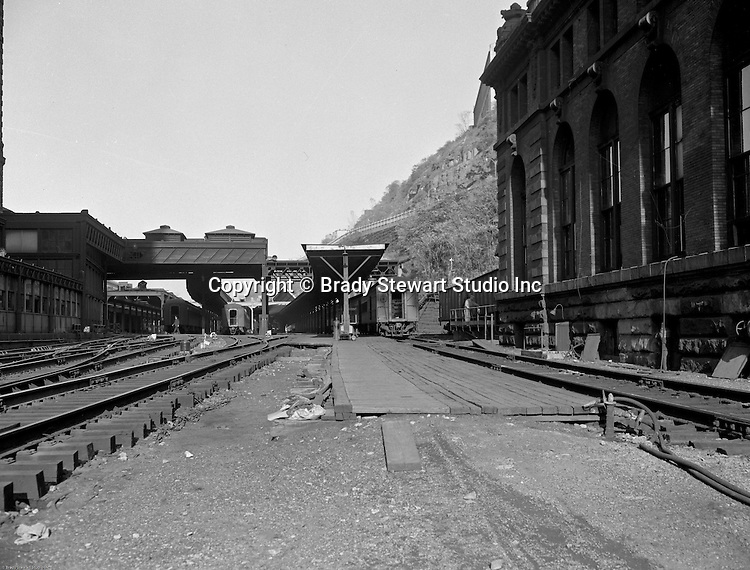Pittsburgh PA:  View of the Pennsylvania Railroad Station yard - 1950s.  The PA Railroad was a very good customer of Brady Stewart Studio until they hired their own photographers in the 1960s. The Union Station building was designed by Chicago architect Daniel Burnham and built 1898–1903.  Since this facility connected the Pennsylvania Railroad with several subsidiary lines, the company renamed it to match other Pennsylvania Stations in 1912. The restoration of Union Station in the mid-1980s converted the office tower into apartments, and is now called The Pennsylvanian which opened to residents on May 23, 1988.
