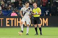 CARSON, CA - SEPTEMBER 15: Daniel Steres #5 of the Los Angeles Galaxy and Ted Unkel have a chat during a game between Sporting Kansas City and Los Angeles Galaxy at Dignity Health Sports Complex on September 15, 2019 in Carson, California.