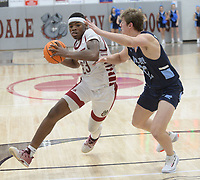 Springdale's Jordan Owens (left) drives to the lane Tuesday, Feb. 11, 2020, as he is pressured by Har-Ber's Noah Livingston during the second half of play in Bulldog Arena in Springdale. Visit nwaonline.com/prepbball/ for a gallery from the games.<br /> (NWA Democrat-Gazette/Andy Shupe)