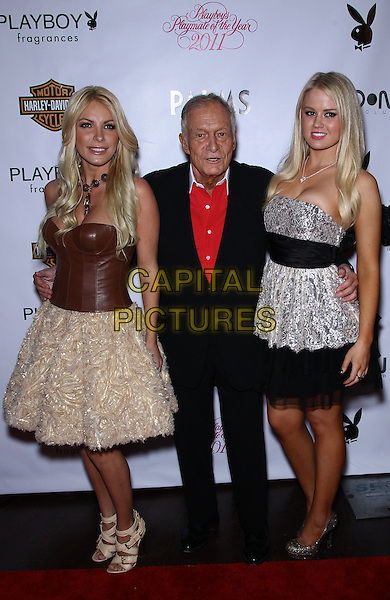 CRYSTAL HARRIS, HUGH HEFNER & ANNA BERGLUND .2011 Playmate of the Year Party at Moon Nightclub inside the Palms Casino Resort,  Las Vegas, Nevada, USA, .6th May 2011..full length fiancee engaged couple black suit red shirt dress  brown leather bustier strapless top beige  sandals ruffles .CAP/ADM/MJT.© MJT/AdMedia/Capital Pictures.