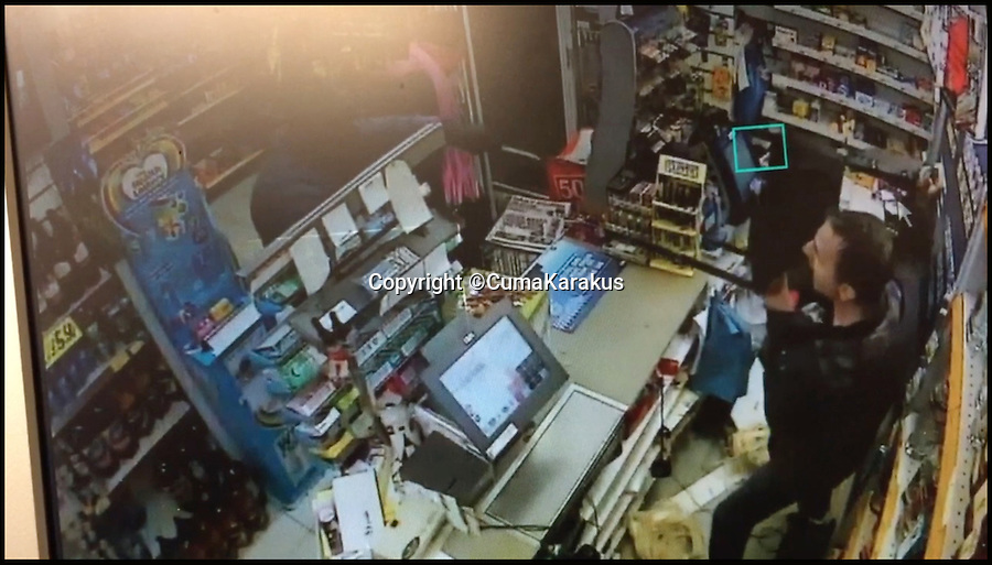 BNPS.co.uk (01202 558833)<br /> Pic: CumaKarakus/BNPS<br /> <br /> The moment Cuma uses he chair to defend himself.<br /> <br /> This is the dramatic movement a heroic shopkeeper scared off a knife-wielding raider by launching a glass jar of dog biscuits at him. <br /> <br /> Brave Cuma Karakus dodged the masked thug's eight inch blade as he jabbed over the counter armed only with the treats he keeps for customers' pets. <br /> <br /> The dad of two then incredibly threw it at the crook as he tried to run around the table, appearing to hit a glancing blow on his hand.