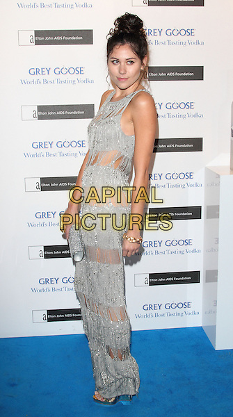 Eliza Doolittle.Elton John AIDS Foundation Grey Goose Winter Ball held at the Battersea Power Station. London, England..November 10th 2012.full length dress maxi hair up bun silver sleeveless tassels fringed sequined sequin see thru through clutch bag see thru through sheer .CAP/ROS.©Steve Ross/Capital Pictures