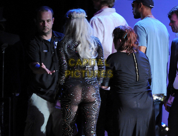 LADY GAGA & CARRIE FISHER .performing with We are Plastic Ono Band on night 2 at The Orpheum Theatre in Downtown Los Angeles, California, USA, October 2nd, 2010..music concert gig half length head band sparkly black fishnet catsuit gem jewel encrusted diamante back rear behind ass bum                                                   .CAP/RKE/DVS.©DVS/RockinExposures/Capital Pictures.