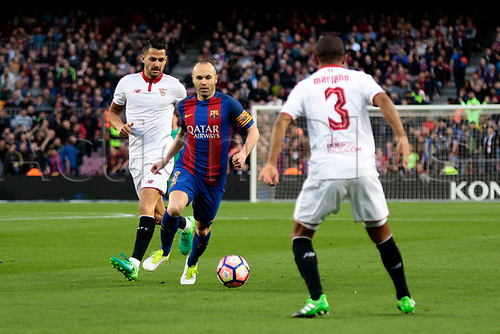 April 5th 2017, Nou Camp, Barcelona, Spain, Spanish La Liga football, FC Barcelona versus Espanyol; Iniesta breaks towards goal and is challenged by Mariano(esp)