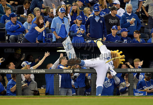 Oct 21, 2014; Kansas City, MO, USA; Kansas City Royals mascot imitates a catch made by third baseman Mike Moustakas (not pictured) before game one of the 2014 World Series against the San Francisco Giants at Kauffman Stadium. Mandatory Credit: Denny Medley-USA TODAY Sports