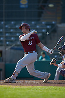 Andrew Cossetti (33) of the Saint Joseph's Hawks follows through on his swing against the Western Carolina Catamounts at TicketReturn.com Field at Pelicans Ballpark on February 23, 2020 in Myrtle Beach, South Carolina. The Hawks defeated the Catamounts 9-2. (Brian Westerholt/Four Seam Images)