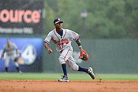 Shortstop Ozhaino Albies (7) of the Rome Braves plays the infield in a game against the Greenville Drive on Sunday, June 14, 2015, at Fluor Field at the West End in Greenville, South Carolina. Rome won, 5-2. (Tom Priddy/Four Seam Images)