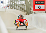 5 December 2014: Daniel Pfister, sliding for Austria, crosses the finish line on his first run, ending the day being disqualified in the Men's Competition at the Viessmann Luge World Cup, at the Olympic Sports Track in Lake Placid, New York, USA. Mandatory Credit: Ed Wolfstein Photo *** RAW (NEF) Image File Available ***