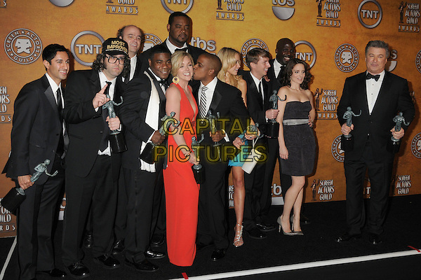 "The cast and creators of ""Slumdog Millionaire"".15th Annual Screen Actors Guild Awards held at the Shrine Auditorium, Los Angeles, California, USA..January 25th, 2009.SAG pressroom full length award trophies trophy red dress black suit tuxedo .CAP/ADM/BP.©Byron Purvis/AdMedia/Capital Pictures."