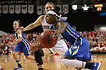 VERMILLION, SD, APRIL 2:  Kaneisha Atwater #2 from Florida Gulf Coast drives against Bridget Arens #22 from the University of South Dakota during the WNIT Championship game Saturday afternoon at the Dakota Dome in Vermillion, S.D. (Photo by Dave Eggen/Inertia)