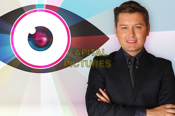 Brian Dowling.Celebrity Big Brother.*Filmstill - Editorial Use Only*.half length black suit jacket purple shirt tie arms crossed.CAP/NFS.Supplied by Capital Pictures.