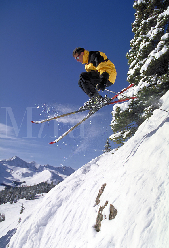 Man, Men, Extreme, Scenic, Active Lifestyle, Winter, Sports, Exercise, Vacation, Skiing, Air, Snow, Jumping, Action, Adventure, Challenge, Copper Mountain, Skier. Rob Ruhl (MR 659). Colorado United States Rocky Mountains, Summit County, Resolution Bowl ,