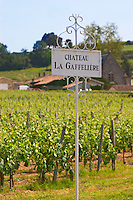 A white sign in the vineyard saying Chateau La Gaffeliere Saint Emilion Bordeaux Gironde Aquitaine France