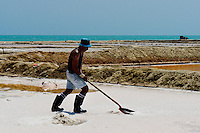 A Colombian man collects salt in the salt mines of Salinas de Manaure, Colombia, 12 May 2007. Manaure, the arid region in northern most part of South America (Guajira Peninsula), with its very hot and dry climate throughout the year and with the naturally formed lagoons, has always been favorable for the salt production. The salt explotation, run in this area by the Wayuu Indians and later by Colombian mestizos, is known since the pre-Columbian era. Although nowadays the salt production reach to one million tons a year, processed both by industrial and artisanal methods, no social or economical development has been marked in the local community. Sea salt industry in Manaure covers the major part of Colombia's salt consumption.