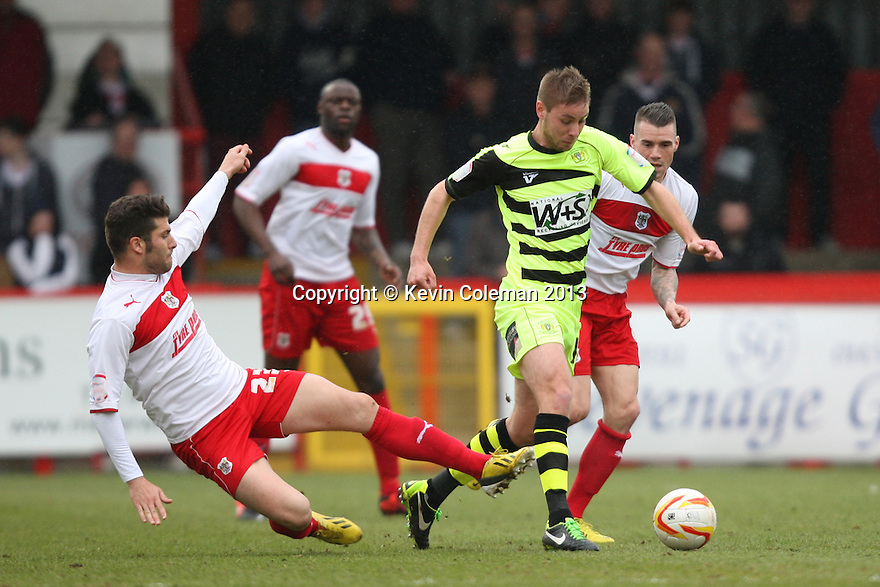 Dani Lopez of Stevenage tackles Paddy Madden of Yeovil . Stevenage v Yeovil Town- npower League 1 -  Lamex Stadium, Stevenage - 13th April, 2013. © Kevin Coleman 2013.. . . . .. . . .  . . .  .