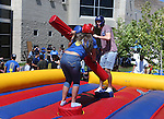 Jay Hoy and Diana Gurrola joust during a student BBQ and club fair at Western Nevada College in Carson City, Nev., on Thursday, Sept. 1, 2016. <br />Photo by Cathleen Allison